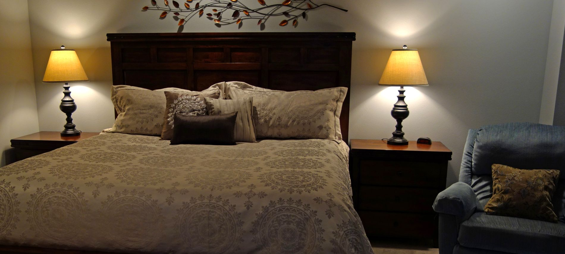 nterior of the room showing light brown linens and dark brown woodwork.